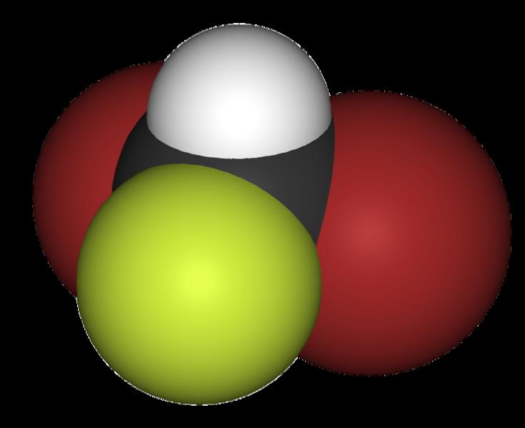 Het molecuul. Wit is waterstof, geel is fluor en zwart koolstof. De atoomkernen van deze drie atomen vormen magneetjes.