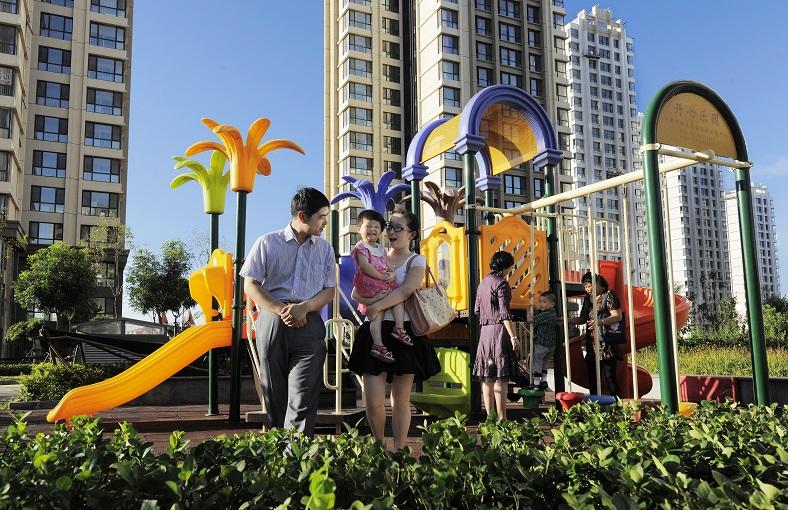Familie in Tianjin Eco City. Bron: overheid van Singapore